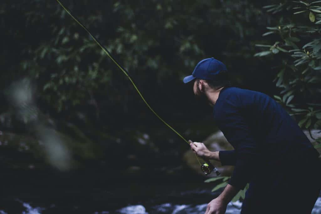 Blurry Photo of man fly fishing