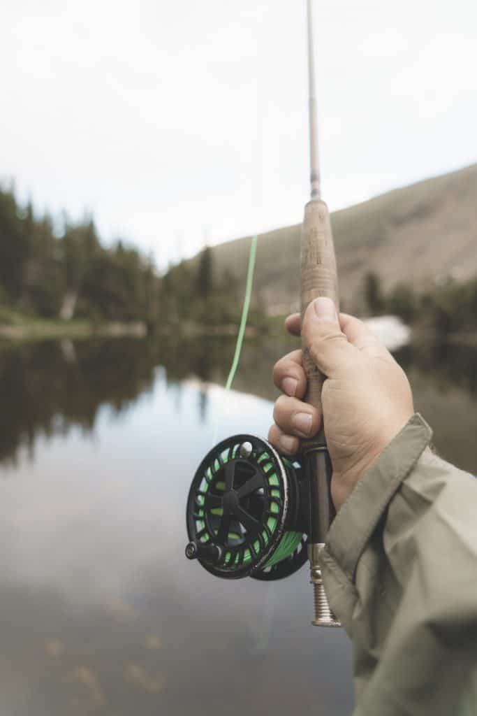 Man holding one of the best bamboo fly rods