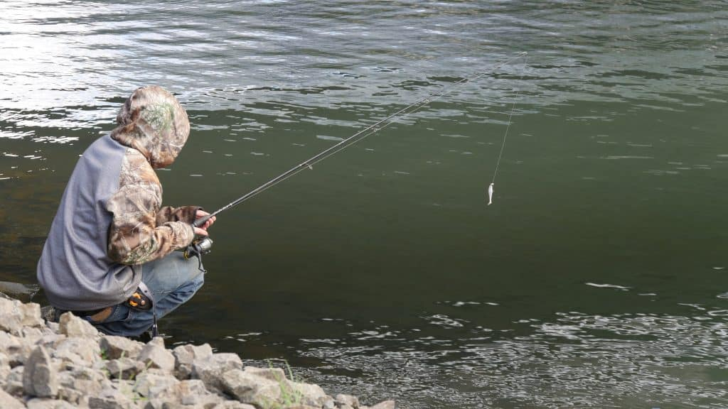 Man fishing with one of the best inshore spinning rods under 100