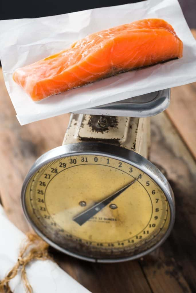 Fresh Organic Salmon Fish on a food scale