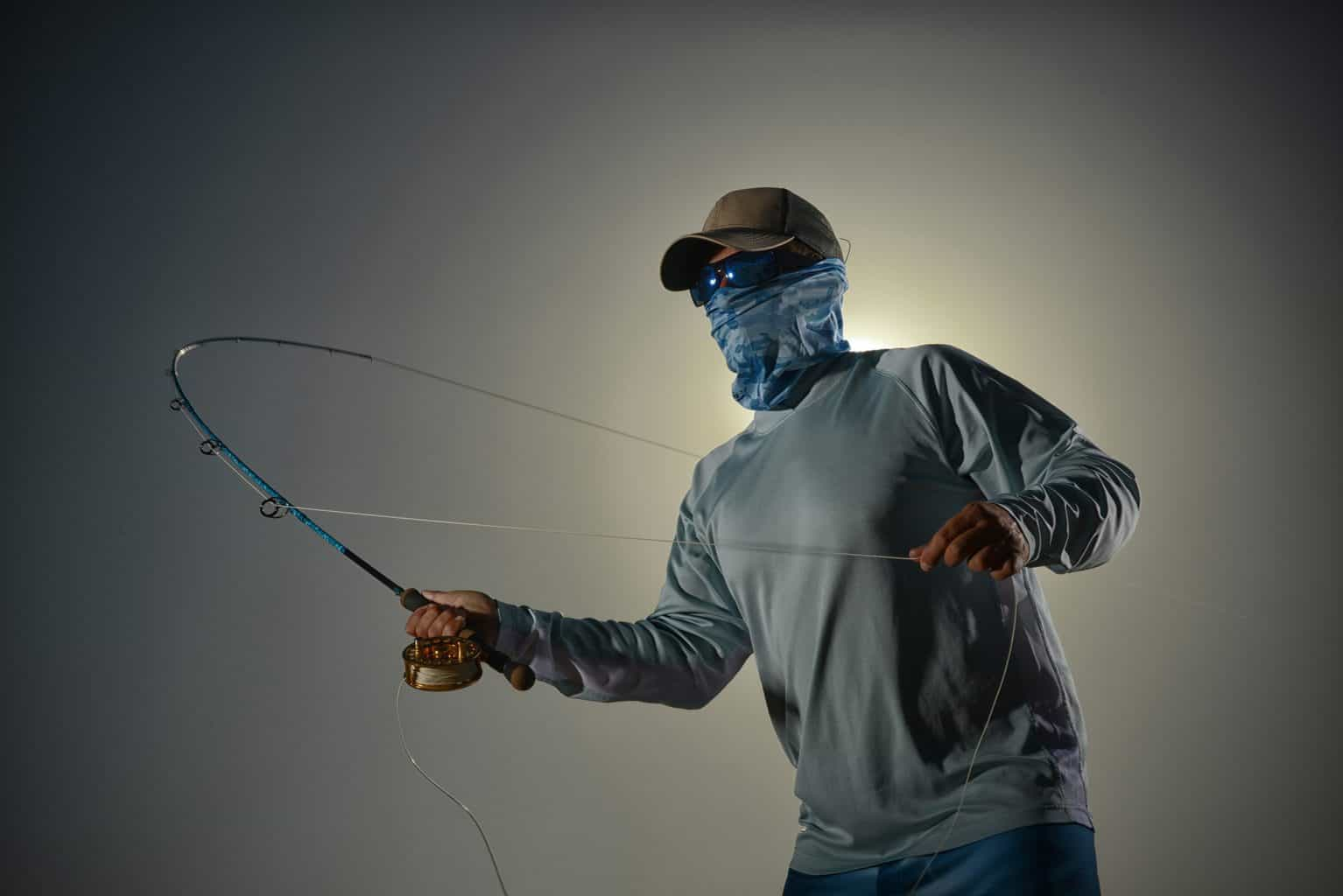 man wearing one of the best best face shield for fishing