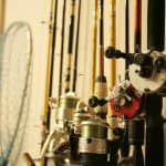Fishing rods on holder in garage showcasing one of the best fishing rod racks