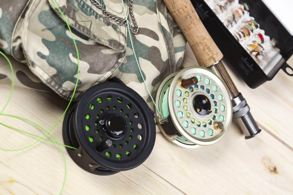 Mooching Reel vs Fly Reel - What are the differences. Fly reels on a wooden surface