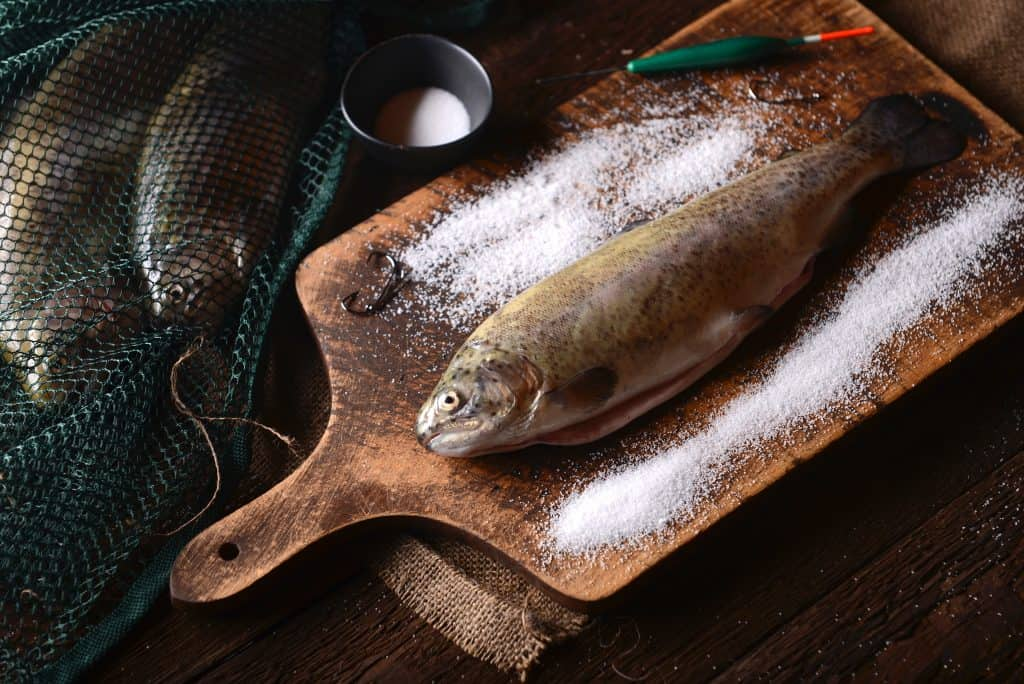 Fresh trouts on wooden background