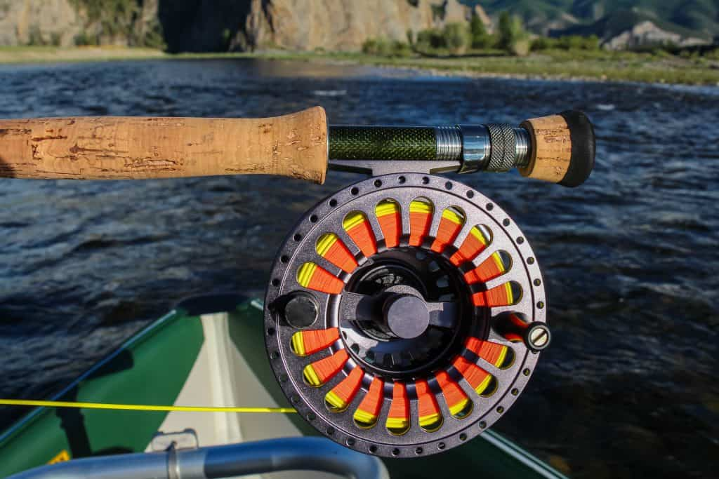 Close up of one of the best fly reel under $200, rod and fly line, in the late evening sun