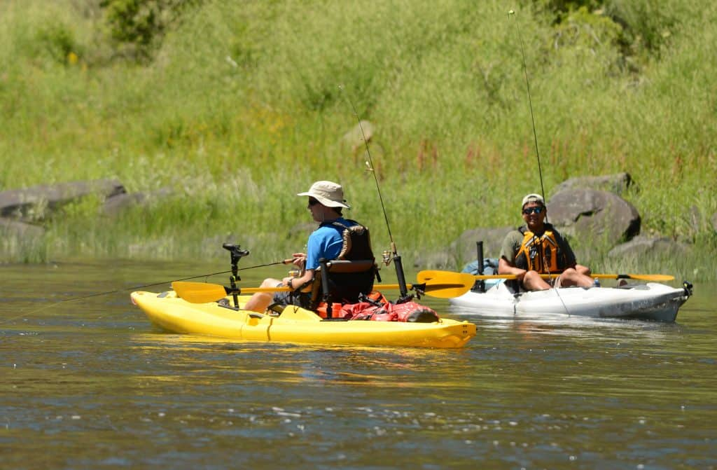 two men fishing and kayaking in a kayak on John Day River in Central Oregon