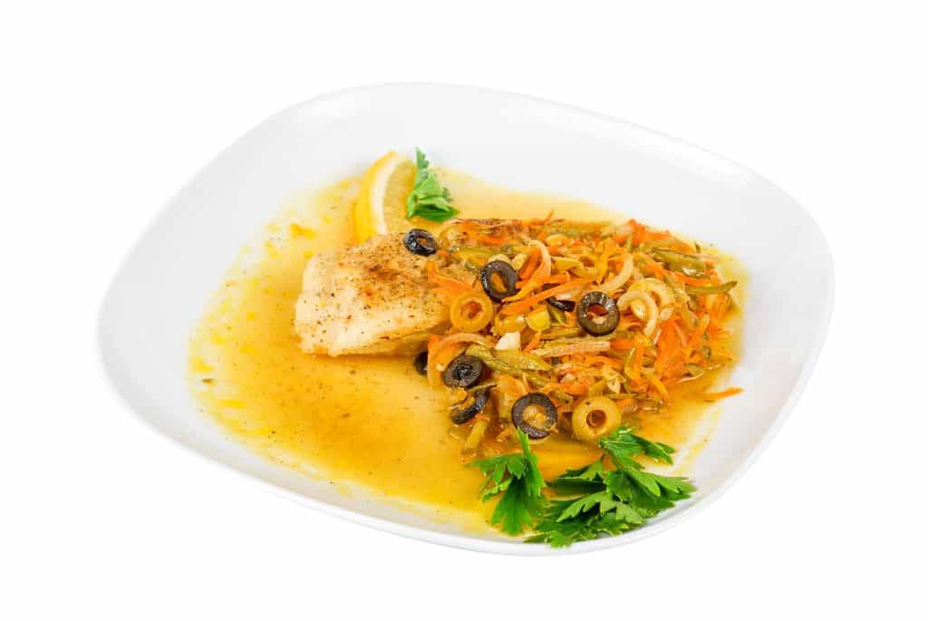 Tasty fish pike perch with mix of vegetables