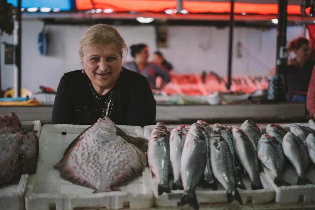 woman selling flounder and other fish